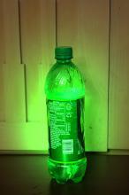Glowing soda bottle